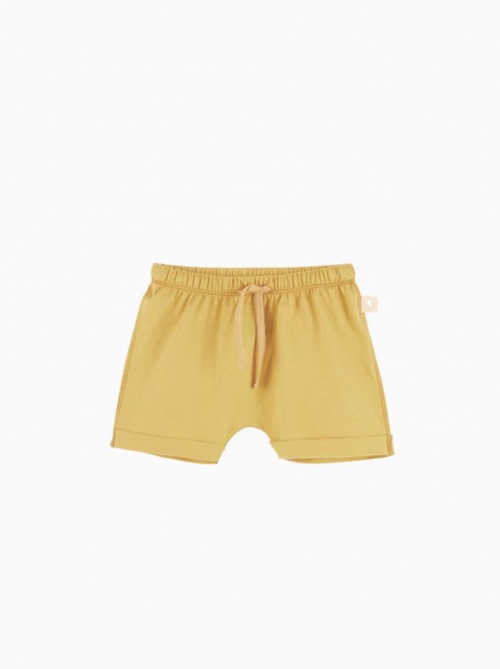 baggy shorts · mustard