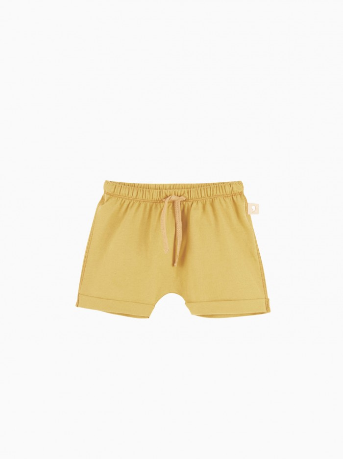 shorts baggy · mostaza